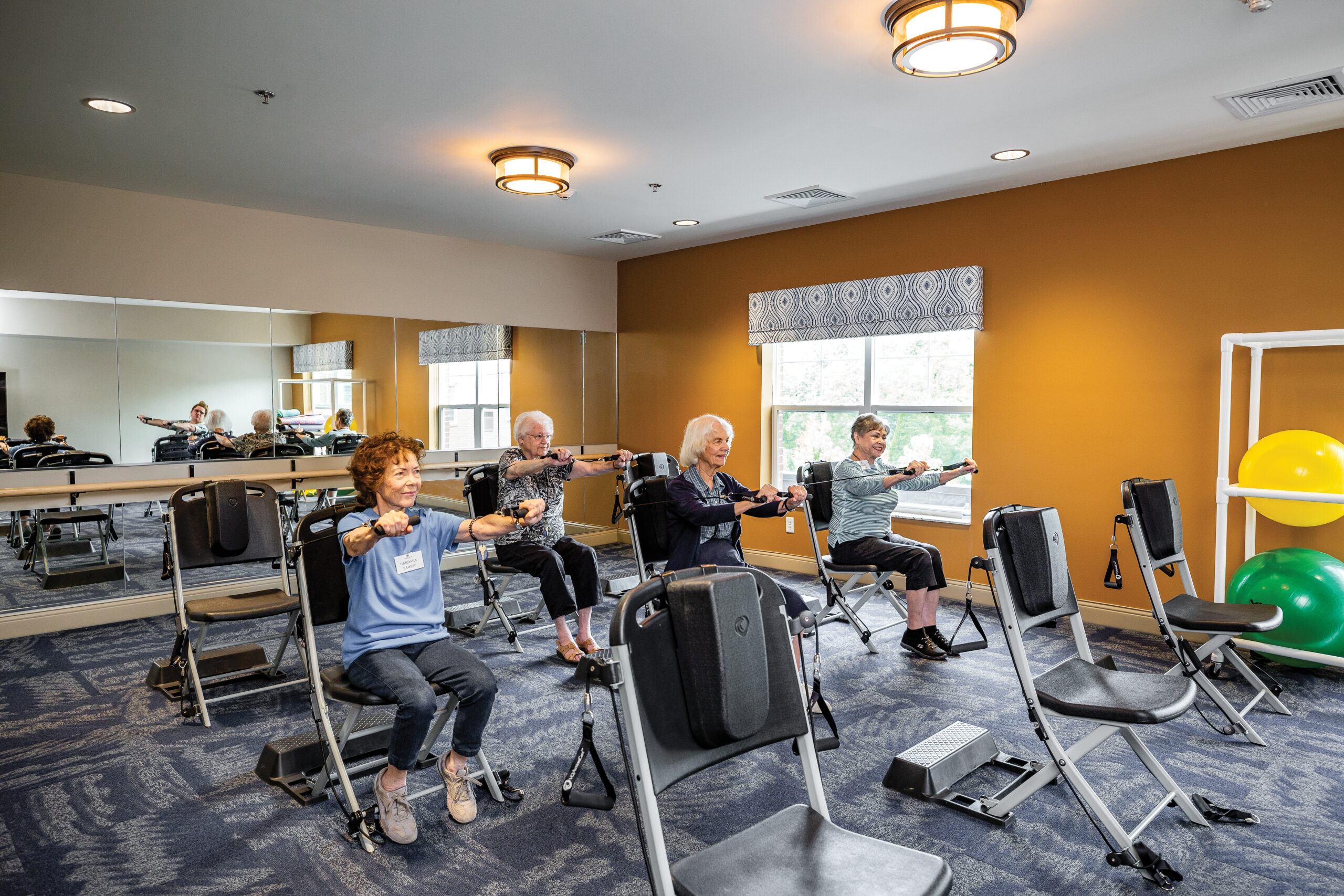 Four women exercising in workout room
